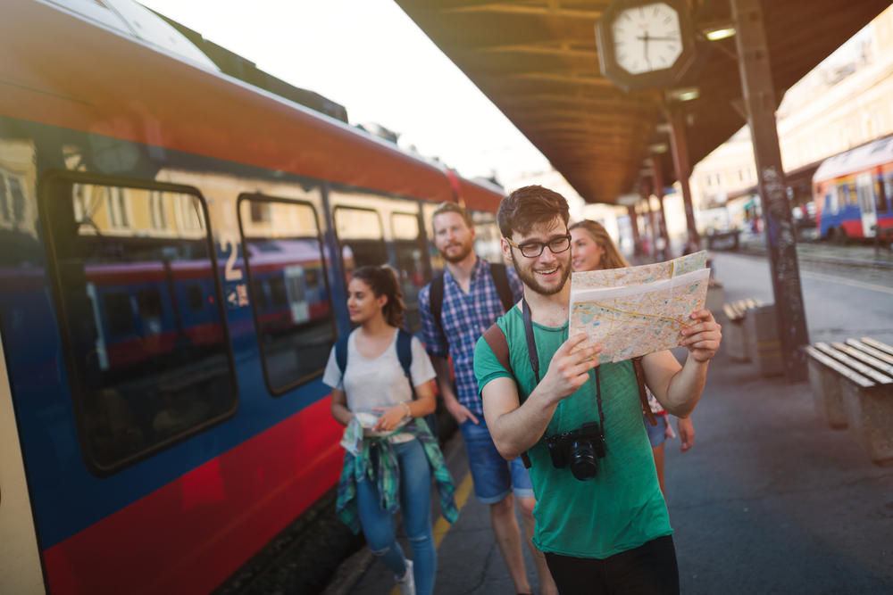 A group of friends learning how to travel as students on a budget and navigate public transport in Europe.