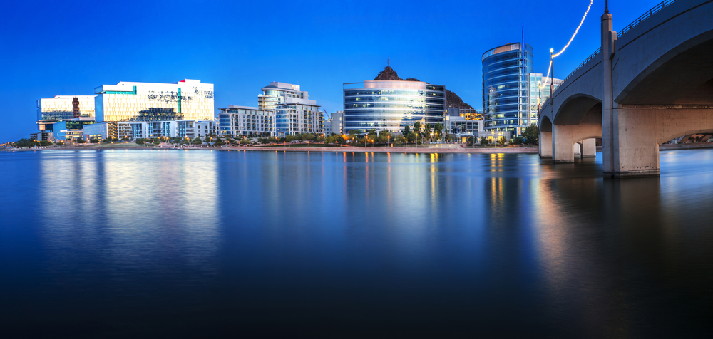 The Tempe city skyline and Salt River photographed during blue hour.