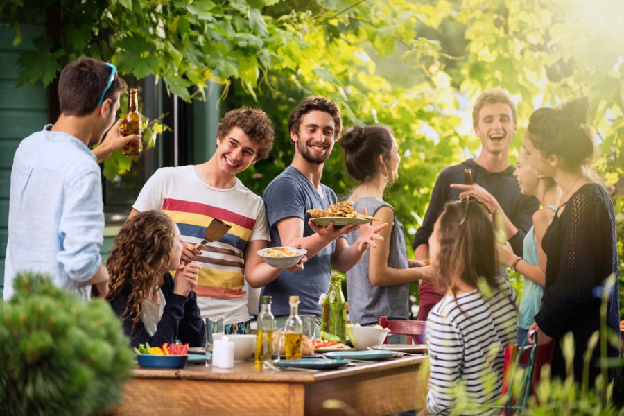 Group of college friends enjoying Friendsgiving party