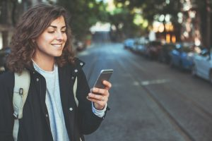 girl smiling and texting back